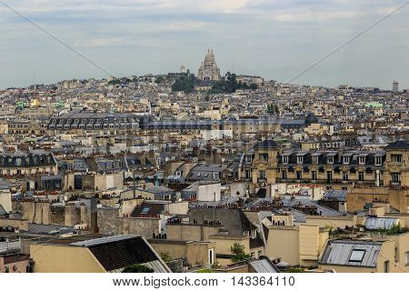 PARIS, FRANCE - MAY 13, 2015: This is aerial view of the hill of Montmartre with basilica Sacre Coeur on top of it.
