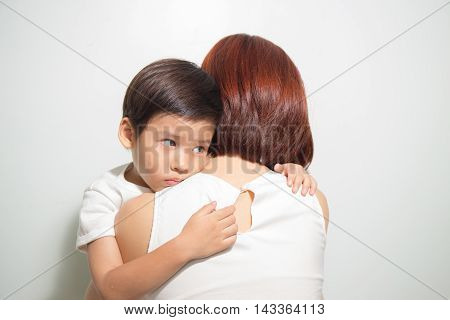 3 years old Asian kid hug his mother on white background