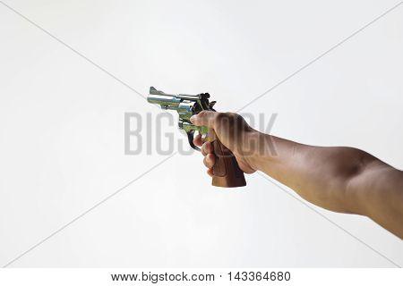 hand aim revolver gun isolated on white background