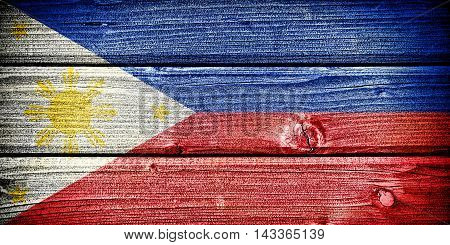 Flag of the Philippines painted on old grungy wooden background: 3d illustration