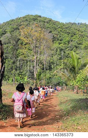 Tak Thailand-Jan 16: Karen children back home after class from border primary school on Jan 16 2015 in Tha Song Yang Tak Thailand. School located in mountain near Thailand-Myanmar border for help and teach Ethnics children