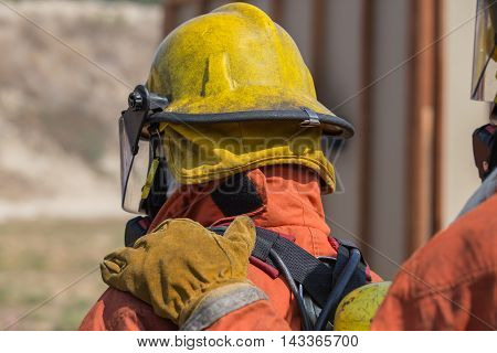 firefighter hand put on shoulder of first man for signal in fire fighting teamwork