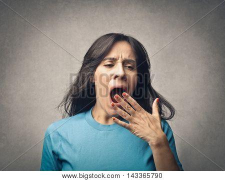 Sleepy woman yawning