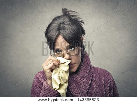 Ill woman holding a handkerchief