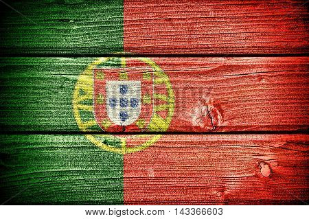 Flag of Portugal painted on old grungy wooden background: 3d illustration