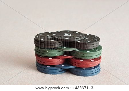 A stack of different color poker chips