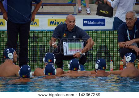 Budapest, Hungary - Jul 17, 2014. Romania's STANOJEVIC Dejan head coach talking about the tactics. The Waterpolo European Championship was held in Alfred Hajos Swimming Centre in 2014.