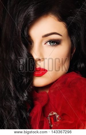 Beautiful Girl. Makeup Long Curly Hair and Red Lips in a Kiss