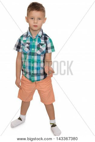Nicely combed little boy in a plaid shirt and pink shorts, holding a coin - Isolated on white background