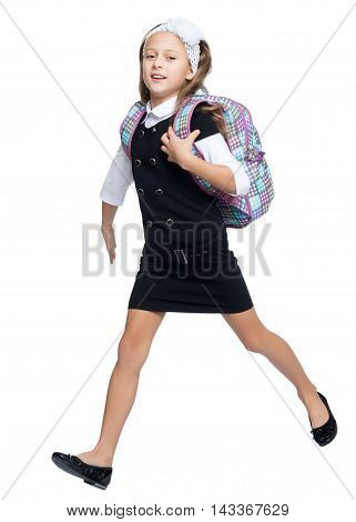 Happy little girl hurries to school . It carries over the shoulder school backpack - Isolated on white background