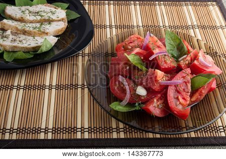 Salad Of Tomato Decorated With Basil And Slices Of Baked Chicken