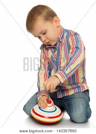 Enthusiastic little boy spinning a top - Isolated on white background