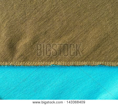 inside with green and blue cloth jacket seam close up texture