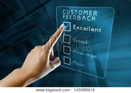 hand clicking online customer  feedback survey on virtual screen interface