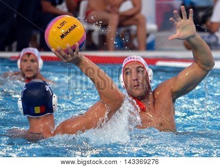 Budapest, Hungary - Jul 17, 2014. IVOVIC Aleksandar (MNE, 9) defending against GHIBAN Alexandru (ROU, 11). The Waterpolo European Championship was held in Alfred Hajos Swimming Centre in 2014.