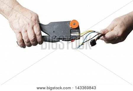 Repair, renovation, electricity and energy concept. Electrician peeling off insulation from wires isolated on white background. Copy space for text. Close up of hands with pliers