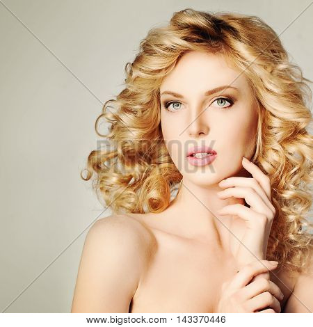 Cute Blonde Woman. Beautiful Girl. Blonde Curly Hair. Spa Portrait