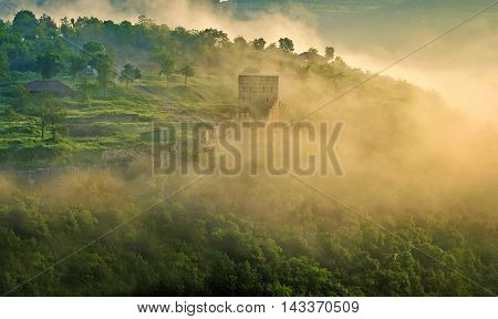 Amazing nature landscape with the nice sunlight. Summer view of the ancient fort at the daybreak. Veliko Tarnovo, Bulgaria.