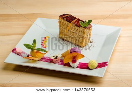 Dessert - Cake with chocoltae Icing and Fresh Mint. Sweet food calorie