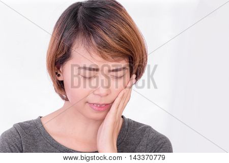 Woman have toothache on white background, symptoms of toothaches typically involve some kind of ache or pain in the jaws or gums