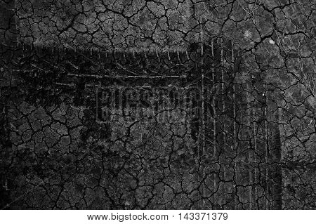 Tire tracks on the dry ground wallpaper