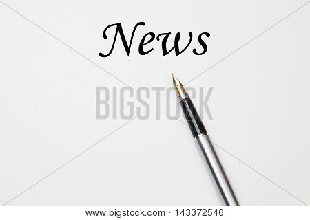 Fountain pen on news text, isolated on white