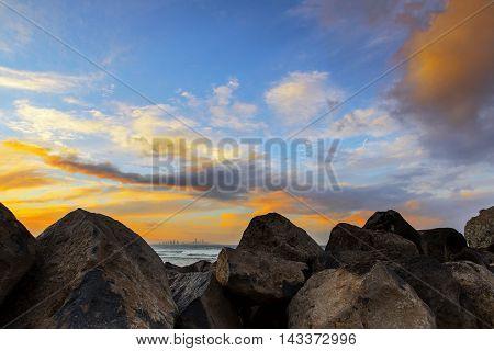 Colourful sunset horizon over the rocks at Currumbin Rock, Gold Coast