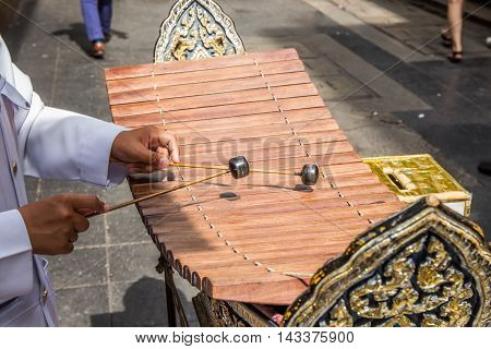 Boy hands playing xylophone,Wooden xylophone called ranat is most prominent instrument in classical Thai music.