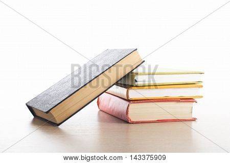 Stack of books on white background. Education concept. Back to school
