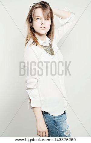 Young Sensual Model Girl Posing. Studio Fashion Photo