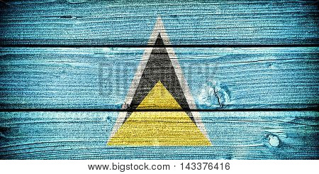 flag of Saint Lucia painted on old grungy wooden background: 3d illustration