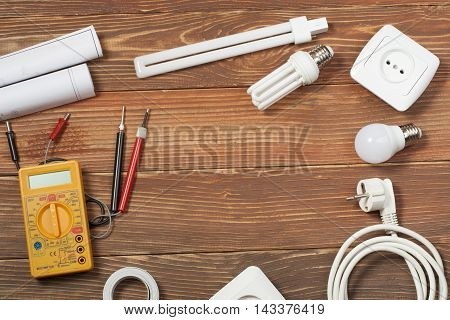 Set of electrical tool on wooden background. Accessories for engineering work, energy concept