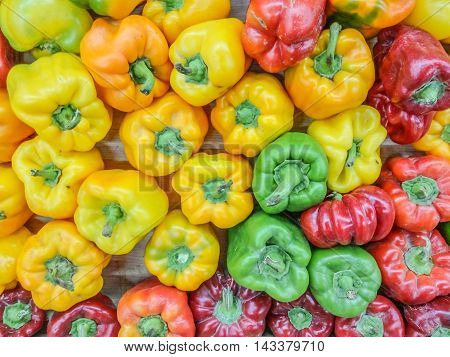 Colorful bell peppers natural background on the desk