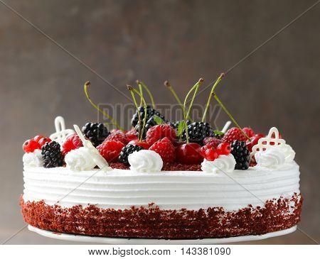 festive cake red velvet decorated with fresh berries