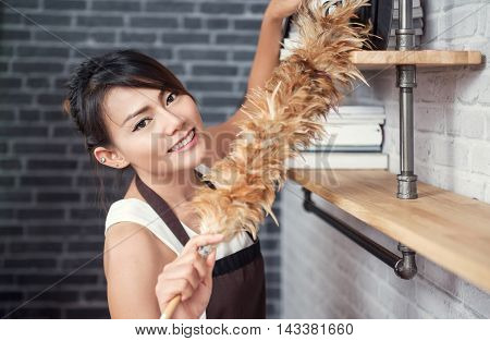 Asian woman cleaning house happy moodfocus on face