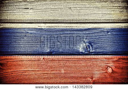 flag of Russia painted on old grungy wooden background: 3d illustration