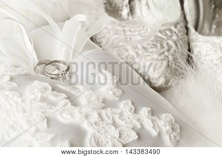 Wedding accessories. Golden rings pillow bridal shoes.