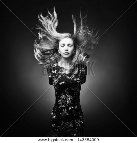 Portrait Of A Young Beautiful Girl With Magnificent Hair On Dark Background