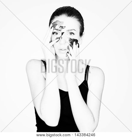 Beautiful young woman on white background in paint