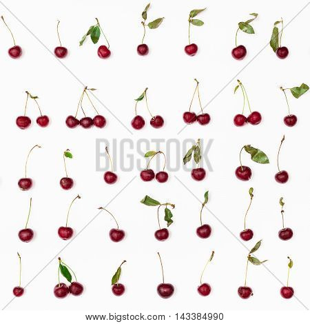 Many Ripe Red Cherries Arranged On White