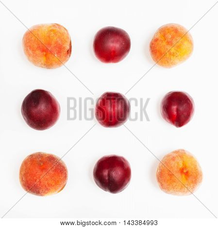 Ripe Nectarines And Peaches Arranged In Square