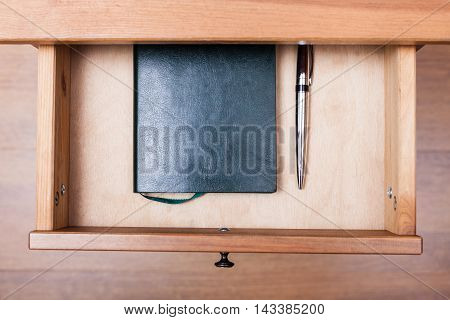 Modern Pen And Notebook In Open Drawer
