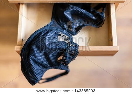 Black Brassiere In Open Drawer