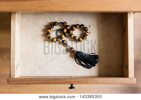 Rosary From Tiger-eye Gems In Open Drawer