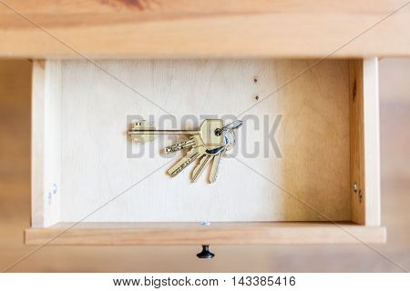 Bunch Of Door Keys In Open Drawer