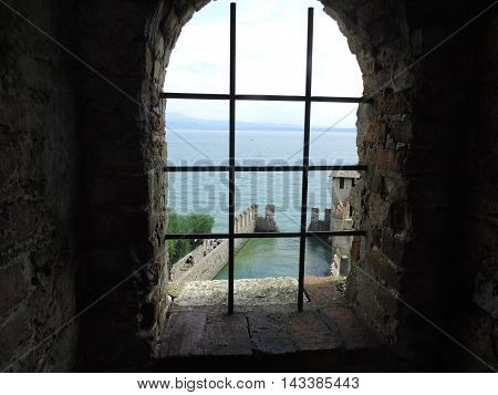 Window in a old castel of Sirmione, on Garda Lake (italy)