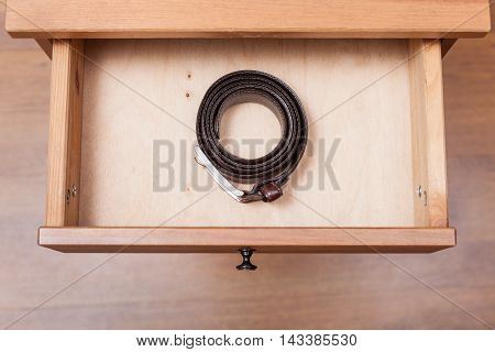 Leather Belt In Open Drawer