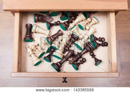 Chess Pieces In Open Drawer