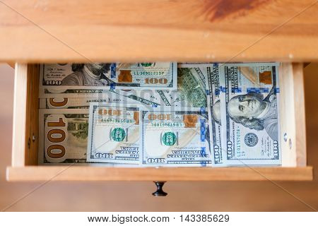 Many Hundred Dollar Banknotes On Bottom Of Drawer