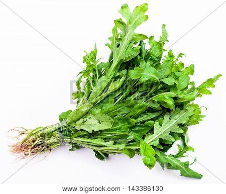 Bunch Of Fresh Cut Green Arugula Herb On White